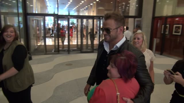 Kellan Lutz going around revolving door twice exits the Time Life building and greets fans before leaving Celebrity Sightings in New York on August...