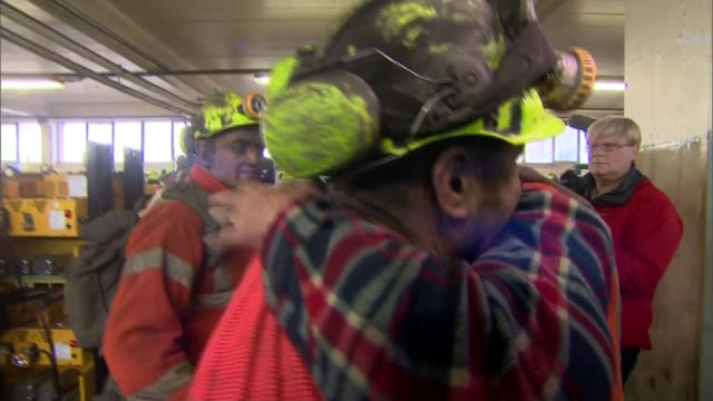 final shift at uk's last deep coal mine miners along into lamp room miners hugging eachother/ gary ward interview sot/ miners from final shift at... - miner stock videos & royalty-free footage