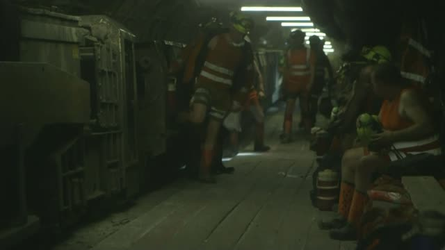 final shift at UK's last deep coal mine UNDERGROUND Miners in pit Mining machinery turning on coal front Miners sitting as otheres get out of train...