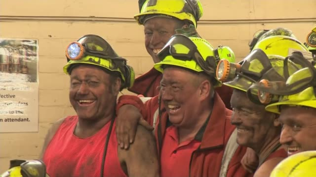 final shift at UK's last deep coal mine INT Various of miners posing for photocall Miners applauding as along