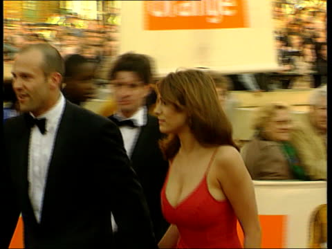 kelly brook signs us tv deal lib business design centre ext kelly brook arriving for royal academy awards ceremony pan - kelly brook stock-videos und b-roll-filmmaterial