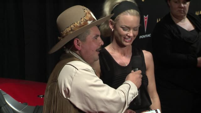 kelly carlson and cowboy friend at the 2006 maxim hot 100 party at buddha bar in new york, new york on may 18, 2006. - ブッダバー点の映像素材/bロール