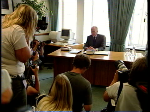 kelly death: inquiry; itn england: london: int cms lord hutton sitting reading at desk photographers taking pictures of hutton at desk hutton from... - surrounding stock videos & royalty-free footage