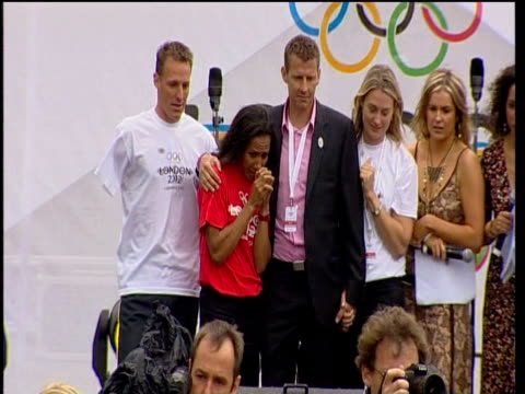 kelly holmes and steve cram react with jubilation along with other members of olympic bid team to announcement that london is to be host city for... - bid stock videos & royalty-free footage