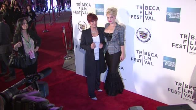 kelly osbourne and sharon osbourne at the 2011 tribeca film festival - premiere of 'god bless ozzy osbourne' at new york ny. - シャロン オズボーン点の映像素材/bロール