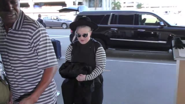 kelly osbourne departing at lax airport in los angeles in celebrity sightings in los angeles - kelly osbourne stock videos and b-roll footage
