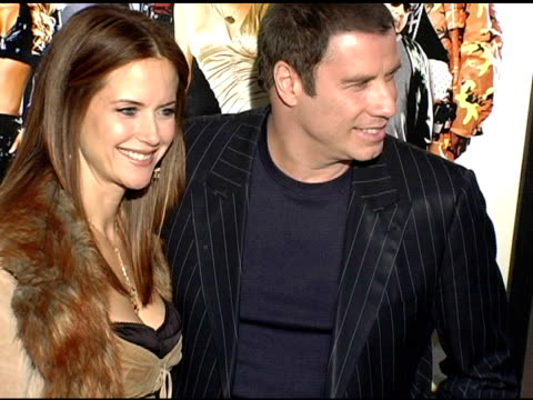 kelly preston and john travolta at the 'be cool' los angeles premiere at grauman's chinese theatre in hollywood california on february 14 2005 - kelly preston stock-videos und b-roll-filmmaterial