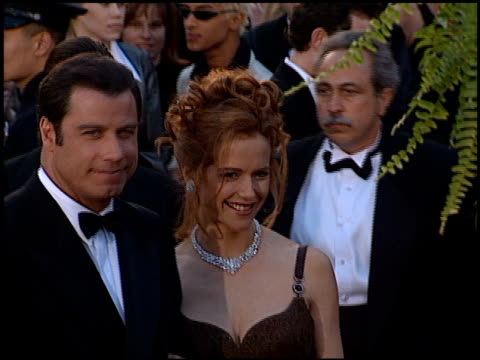 vídeos de stock e filmes b-roll de kelly preston at the 1996 academy awards arrivals at the shrine auditorium in los angeles california on march 25 1996 - 68.ª edição da cerimónia dos óscares
