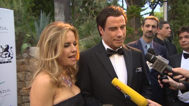kelly preston, john travolta at puerto azul experience on may 21, 2014 in cannes, france. - azul stock videos & royalty-free footage