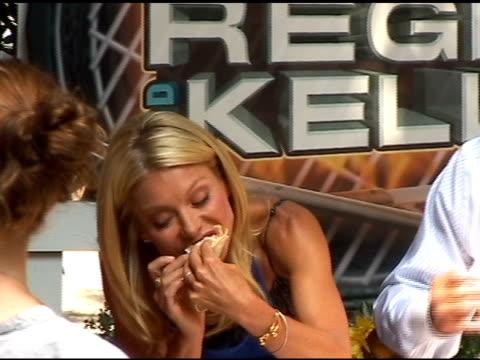 kelly ripa and regis philbin enjoy tacos on 'live with regis kelly' in new york 08/04/11 - regis philbin stock videos and b-roll footage