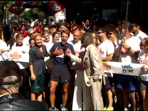 kelly ripa dean karnazes and regis philbin celebrate dean's completion of his amazing run across america at 'live with regis kelly in new york... - regis philbin stock videos and b-roll footage