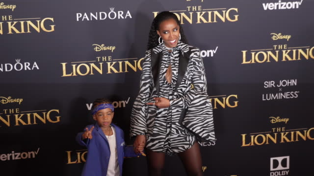 Kelly Rowland and Titan Jewell Weatherspoon at the World Premiere of Disney's The Lion King at Dolby Theatre on July 09 2019 in Hollywood California