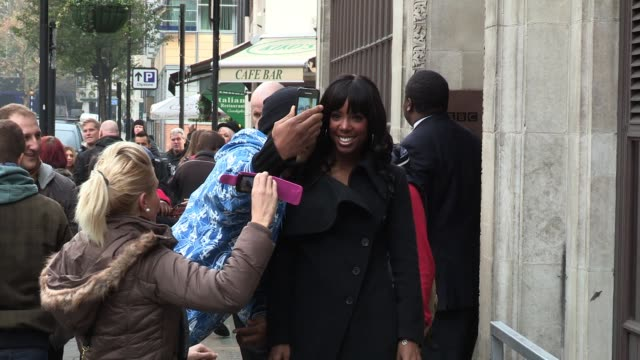 kelly rowland leaves bbc radio one after promoting her acts on the current season of x factor. sighted: kelly rowland at bbc radio one studios on... - リアリティー番組点の映像素材/bロール