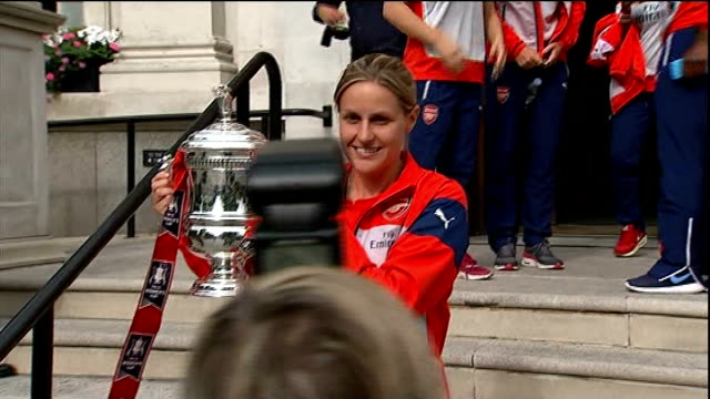 Kelly Smith retires from international football T14071451 Islington Town Hall EXT Kelly Smith and members of Arsenal Ladies football team pose on...