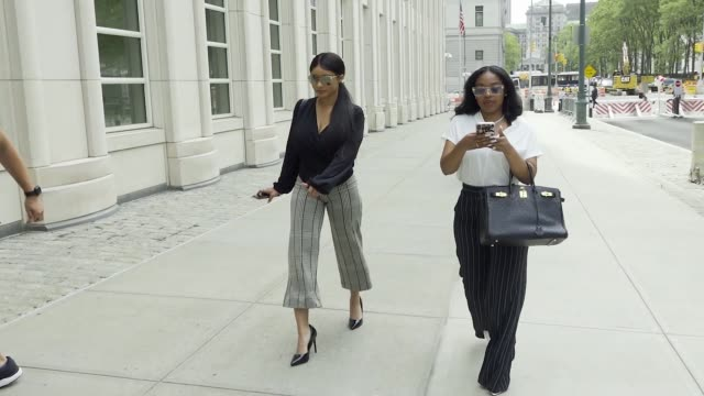 kelly's girlfriends, jocelyn savage and azriel clary enter the brooklyn federal court building during the second hearing of american singer and... - songwriter stock videos & royalty-free footage
