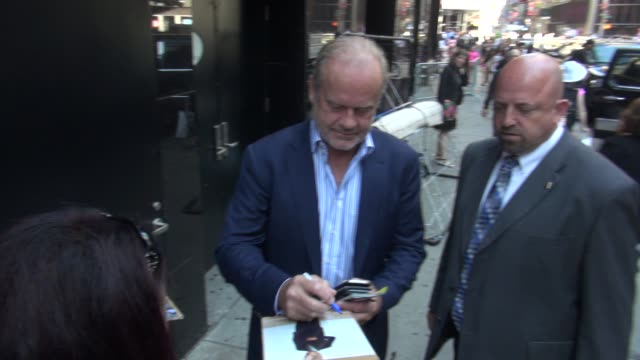 kelsey grammer exits the good morning america show in times square & signs for & poses with fans before getting into his car in celebrity sightings... - new age stock videos & royalty-free footage