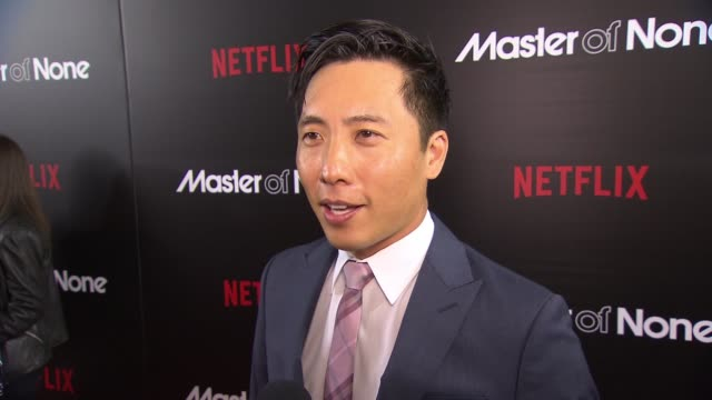 interview kelvin lu discusses the show and how every episode is unique at master of none new york premiere at amc loews 19th street theater on... - amc loews stock videos and b-roll footage