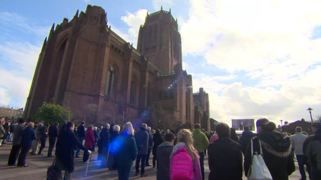 ken dodd funeral liverpool anglican cathedral ext mourners stand outside cathedral listening to ken dodd funeral service sound overlay jimmy tarbuck... - jimmy tarbuck stock videos & royalty-free footage