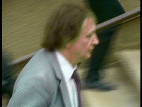 Acquittal ENGLAND Liverpool Queen Elizabeth II Law Courts EXT Ken Dodd arriving at court surrounded by press Anne Jones arriving and up steps Dodd...