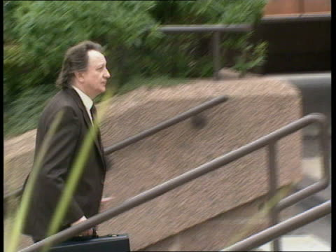 ken dodd tax fraud trial; itn england: liverpool: ext tms side ken dodd up steps of court l-r cms ken dodd towards as says 'morning' to press side... - ブランド名点の映像素材/bロール