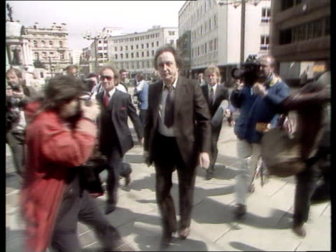 liverpool ms ken dodd up steps towards lms dodd towards as press film and past rl to bv track forward behind him woman fan grasps his hand as past... - ken dodd stock videos & royalty-free footage