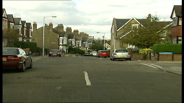 Ken Livingstone condemns road humps Location unknown Car driving slowly along residential street over speed hump TRACK