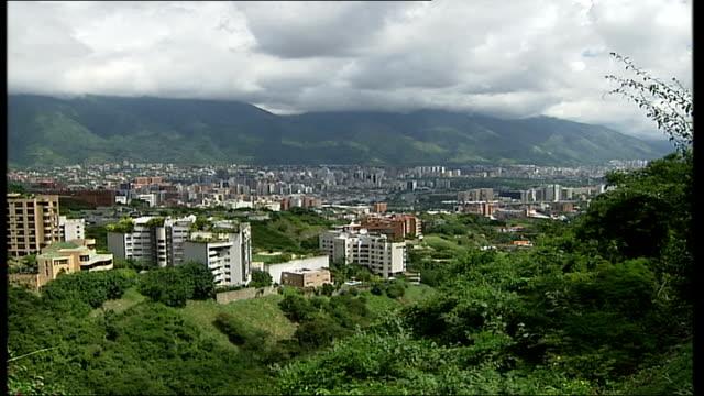 Ken Livingstone justifies cancelled Venezuela trip TX Caracas General views of city Election poster featuring Hugo Chavez