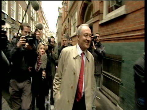 Ken Livingstone Mayor of London walks down road surrounded by press laughing on day he rejoined labour party 06 Jan 04