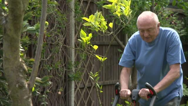 ken livingstone mowing his lawn - gardening stock videos & royalty-free footage