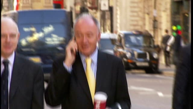 stockvideo's en b-roll-footage met ken livingstone says tory party 'riddled' with homosexuality livingstone along speaking on mobile phone and holding costa coffee cup - ken livingstone