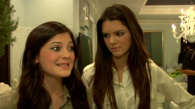 stockvideo's en b-roll-footage met kendall jenner kylie jenner on their family's love for chrismtas at the kendall jenner and sony playstation celebrate their 15th birthday at hidden... - 2010