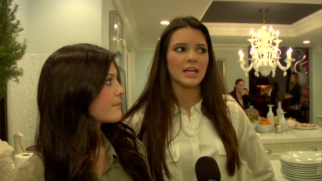 vídeos de stock, filmes e b-roll de kendall jenner kylie jenner on what kendall's sisters got her for her birthday at the kendall jenner and sony playstation celebrate their 15th... - 2010