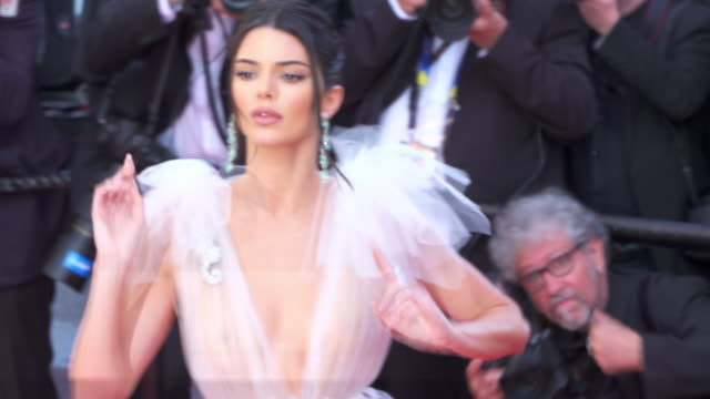 vídeos de stock, filmes e b-roll de kendall jenner shines on the red carpet during cannes film festival 2018 - 2018