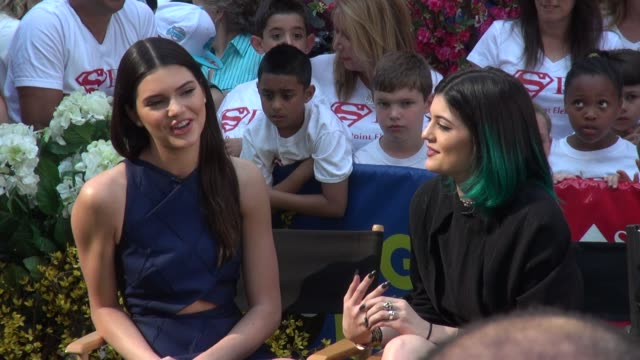 kendall & kylie jenner being interviewed on the outside set of the good morning america show in times square in celebrity sightings in new york, - 黒のドレス点の映像素材/bロール