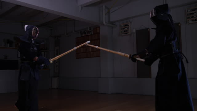 kendo practice in dojo, tokyo, japan. - competitive sport stock videos & royalty-free footage
