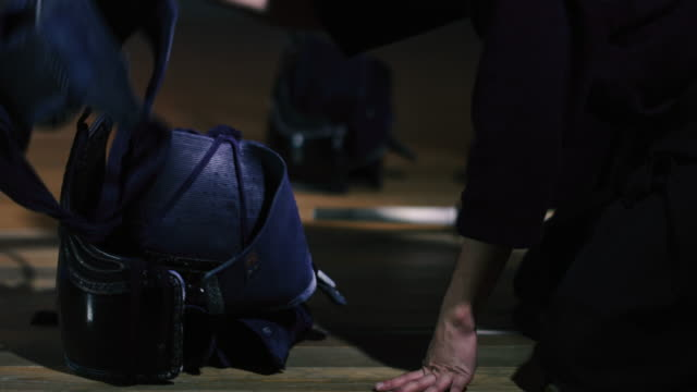 kendo practitioners getting ready for fight in dojo, tokyo, japan. - traditional armor stock videos and b-roll footage