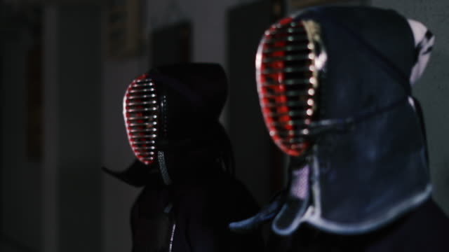 Kendo practitioners getting ready for fight in Dojo, Tokyo, Japan.