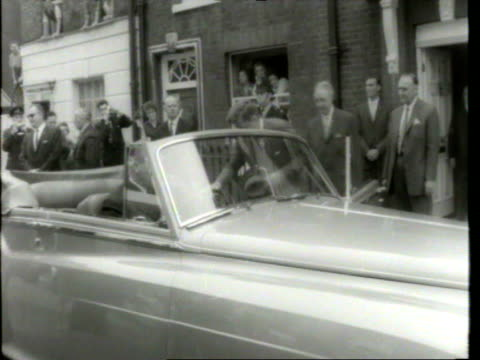 stockvideo's en b-roll-footage met kennedy and macmillan entering building past crowd/ kennedy and macmillan leaving building/ london england/ audio - jacqueline kennedy