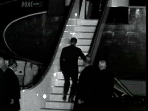 kennedy assassination: london funeral departures; a: england, london, heathrow, lap: ext / night prince philip, duke of edinburgh along tarmac l-r bv... - alec douglas home video stock e b–roll