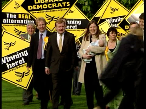 Kennedy towards with wife Sarah holding baby son Donald SCOTLAND Ross Skye and Lochaber Constituency INT Kennedy along into building with Sarah as...