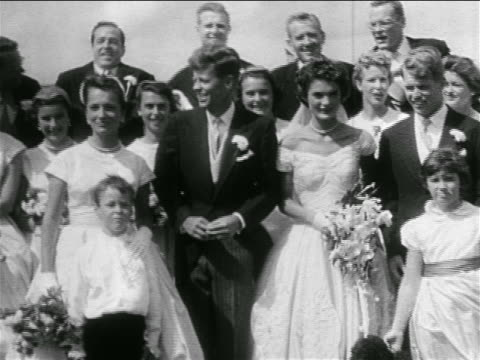 kennedy/bouvier wedding party posing outdoors / newport, ri / newsreel - john f. kennedy us president stock videos & royalty-free footage