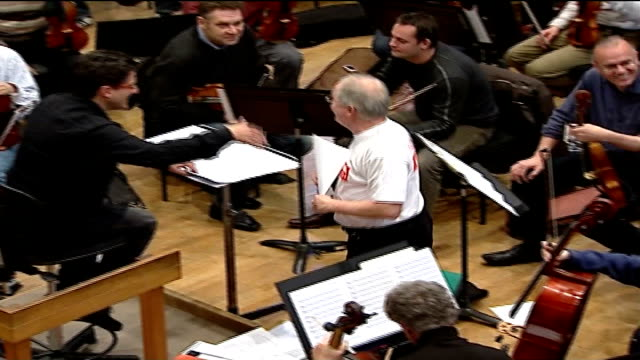 kenneth branagh to direct charity concert for leukaemia research int london symphony orchestra rehearsing for concert top shot patrick doyle along to... - london symphony orchestra stock videos & royalty-free footage