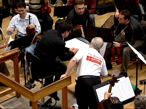 kenneth branagh to direct charity concert for leukaemia research interviews with branagh and patrick doyle / rehearsals more of doyle speaking with... - london symphony orchestra stock videos & royalty-free footage