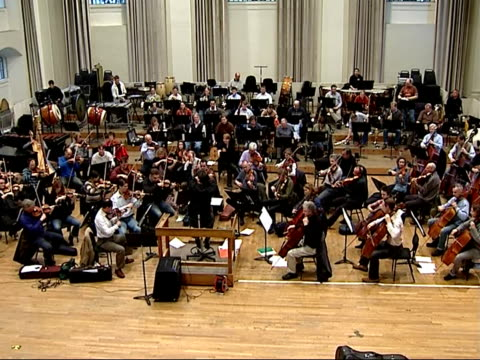 kenneth branagh to direct charity concert for leukaemia research interviews with branagh and patrick doyle / rehearsals london symphony orchestra... - london symphony orchestra stock videos & royalty-free footage
