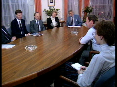 london seq kenneth clarke sitting with doctors at meeting laughing smiling as comments that his job is seriously affecting private life hasn't been... - kenneth clarke stock-videos und b-roll-filmmaterial