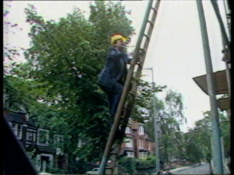 kenneth clarke profile tx11987 itn handsworth ms clarke climbing ladder in hardhattilt ms clarke with workers on roof of building cms clarke bv along... - handsworth stock videos & royalty-free footage