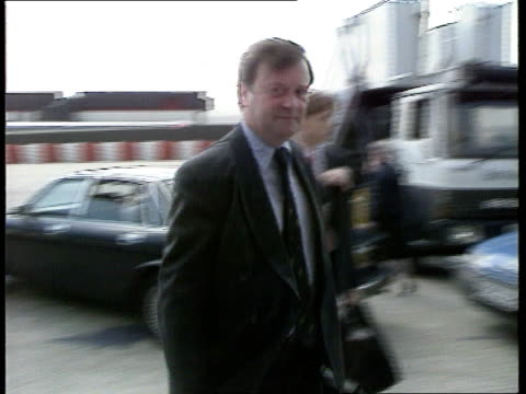 kenneth clarke standing for photocall with eddie george ext ms side part of british midland aircraft ms kenneth clarke out of car on tarmac pan lr as... - kenneth clarke stock-videos und b-roll-filmmaterial