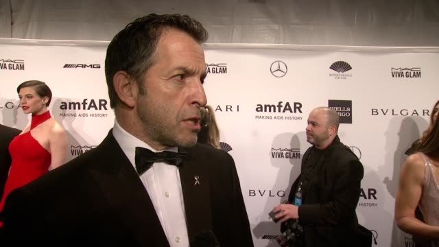 interview kenneth kole on being the chairman of amfar since 2005 on how far they've come on countdown to a cure and on tonight's honorees amfar new... - 会長点の映像素材/bロール