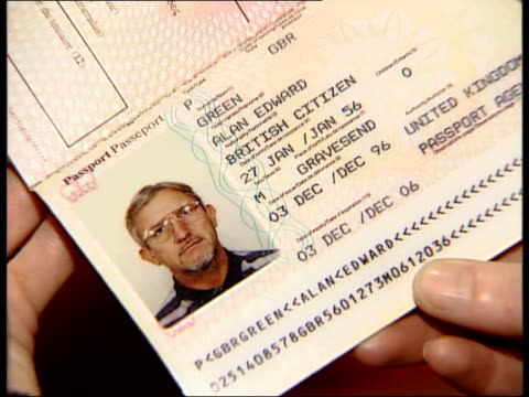 kenneth noye found guilty of murder; kenneth noye found guilty of murder; itn england: london: int cms kenneth noye's fake passport held zoom in ext... - kenneth noye stock videos & royalty-free footage