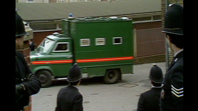 kenneth noye road rage murder appeal begins; lib / exact date unknown green police van along road noye being led from van under a blanket lib /... - kenneth noye stock videos & royalty-free footage